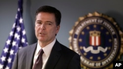 FILE - FBI Director James Comey is seen during a news conference.