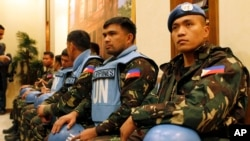 Some of the 21 Filipino United Nations (UN) peacekeepers who were kidnapped by Yarmouk Martyrs Brigade in 2013.