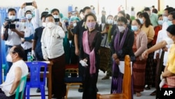 Myanmar leader Aung San Suu Kyi, center, inspects the vaccination processes to health workers at a hospital Wednesday, Jan.27, 2021, in Naypyitaw, Myanmar.