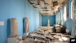 FILE - This file photo released March 27, 2016, by the Syrian official news agency shows destroyed statues at the damaged Palmyra Museum, in the city of Palmyra, Syria. Palmyra, the archaeological gem that Islamic State fighters retook Dec. 11, 2016, from from Syrian troops, is a desert oasis and a UNESCO world heritage site.