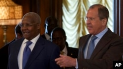 FILE - Russian Foreign Minister Sergey Lavrov, right, welcomes Ugandan counterpart Sam Kutesa, Moscow, May 12, 2014.