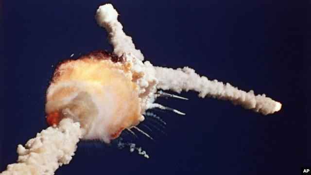 FILE - The space shuttle Challenger explodes shortly after lifting off from the Kennedy Space Center in Cape Canaveral, Florida, Jan 28, 1986.
