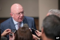 FILE - Russia's U.N. Ambassador Vassily Nebenzia speaks to reporters after attending a Security Council meeting, Aug. 9, 2017, at United Nations headquarters.
