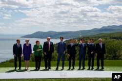 FILE - G-7 summit participants pose for a family photo in Charlevoix, Canada, June 8, 2018.