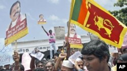 Sri Lankan government supporters hold placards against Britain's Channel 4 television during a protest in Colombo, Sri Lanka. Hundreds of government supporters, including state-run media journalists, protested Tuesday in Colombo against the UK channel wit
