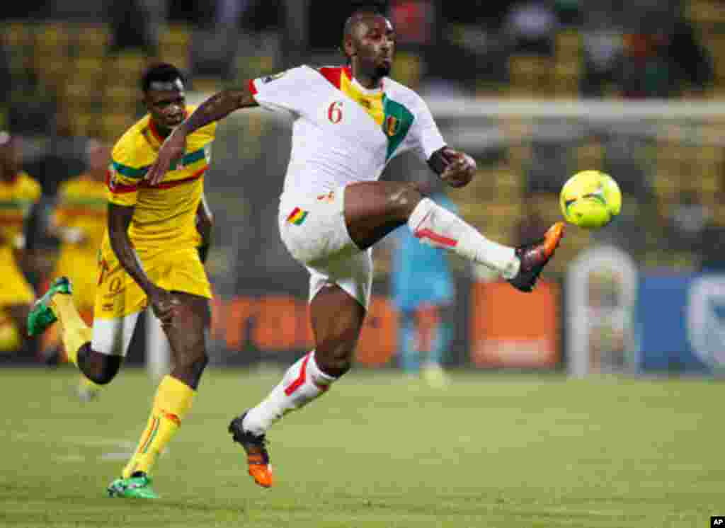 Mali's Cheick Tidiane Diabate challenges Guinea's Kamil Zayatte for the ball during their African Nations Cup Group D soccer match at Franceville Stadium