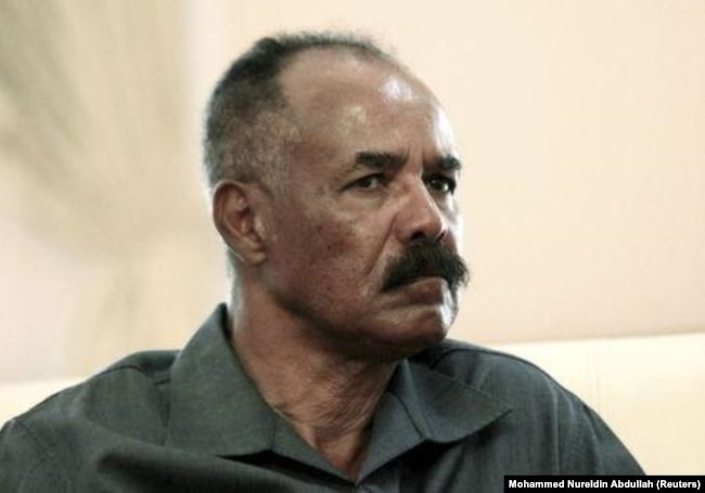 FILE - Eritrea's President Isaias Afwerki listens during his official visit in Khartoum, June 11, 2015.
