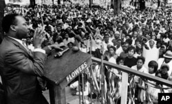 The Rev. Martin Luther King Jr. addresses a crowd of some 3,000 persons, April 30, 1966, in Kelly Ingram Park on the last day of his three-day whistle-stop tour of Alabama.