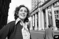 FILE - Susan Brownmiller is shown on the streets of lower Manhattan in New York, Oct. 18, 1975.