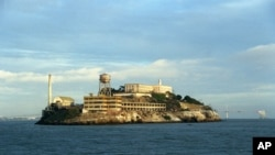 Alcatraz Island is shown in San Francisco, Oct. 22, 2001. The cellhouse is shown in the background up on the hill next to the water tower, and in the foreground is the model industries building where the prisoners washed clothes, among other tasks.
