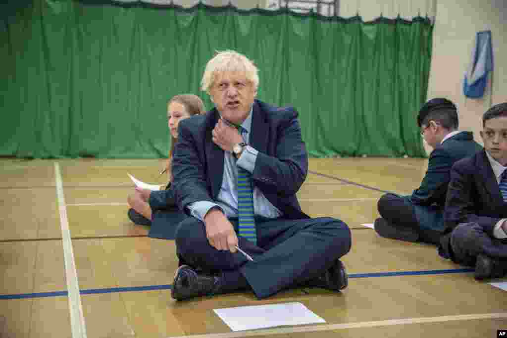 Britain's Prime Minister Boris Johnson is seen during a visit to Castle Rock school on the students' first day back, in Coalville, East Midlands, England.