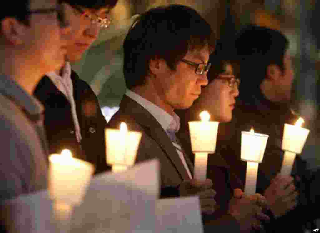 South Koreans take moment of silence for South Korean marines killed in a North Korean bombardment during a rally against North Korea's attack onto South Korean island, in Seoul, South Korea, Tuesday, Nov. 23, 2010. North Korea shot dozens of rounds of ar