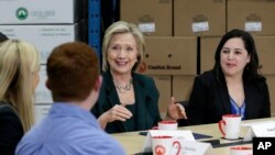 Democratic presidential candidate Hillary Rodham Clinton, center, speaks during a small business roundtable, April 15, 2015, in Norwalk, Iowa.
