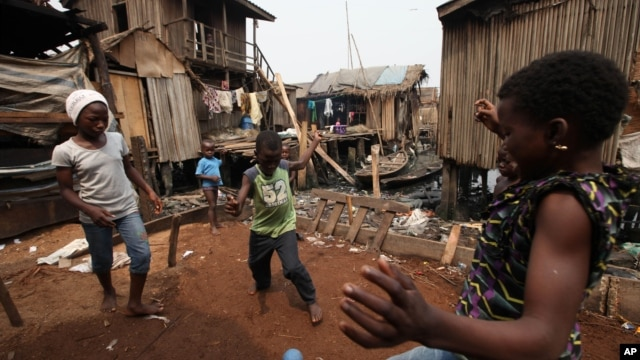 Children play in the Makoko slum in Lagos, Nigeria, where houses sit on stilts above polluted waters of the Lagos lagoon, January 21, 2011.
