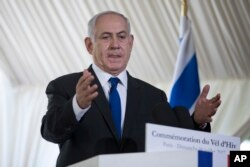 Israeli Prime Minister Benjamin Netanyahu gestures as he delivers a speech during a ceremony commemorating the 75nd anniversary of the Vel d'Hiv roundup, July 16, 2017 in Paris.