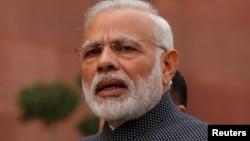 FILE - India's Prime Minister Narendra Modi speaks to the media inside the parliament premises in New Delhi, Nov. 16, 2016.