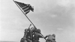 Joe Rosenthal's 1945 photograph of the US Marines of the 28th Regiment of the Fifth Division raising the American flag on Mount Suribachi, Iwo Jima