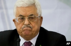 FILE - Palestinian President Mahmoud Abbas says he'll regard the Israeli election winner as 'our partner.'