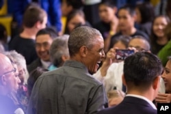 President Barack Obama greets members of the audience after delivering remarks at Kotzebue School, Wednesday, Sept. 2, 2015.