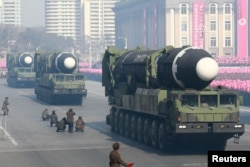 FILE - Intercontinental ballistic missiles are seen at a grand military parade celebrating the 70th founding anniversary of the Korean People's Army at the Kim Il Sung Square in Pyongyang, in this photo released by North Korea's Korean Central News Agency (KCNA) Feb. 9, 2018.