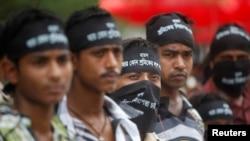 Para pekerja garmen Bangladesh melakukan unjuk rasa menuntut hukuman mati atas pihak yang bertanggung jawab alam ambruknya gedung Rana Plaza di kota Savar (1/5).