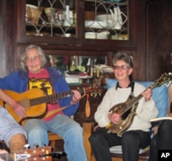 Faith Petric (left) is joined by long-time club member Estelle Freedman on the mandolin at a recent jam session.