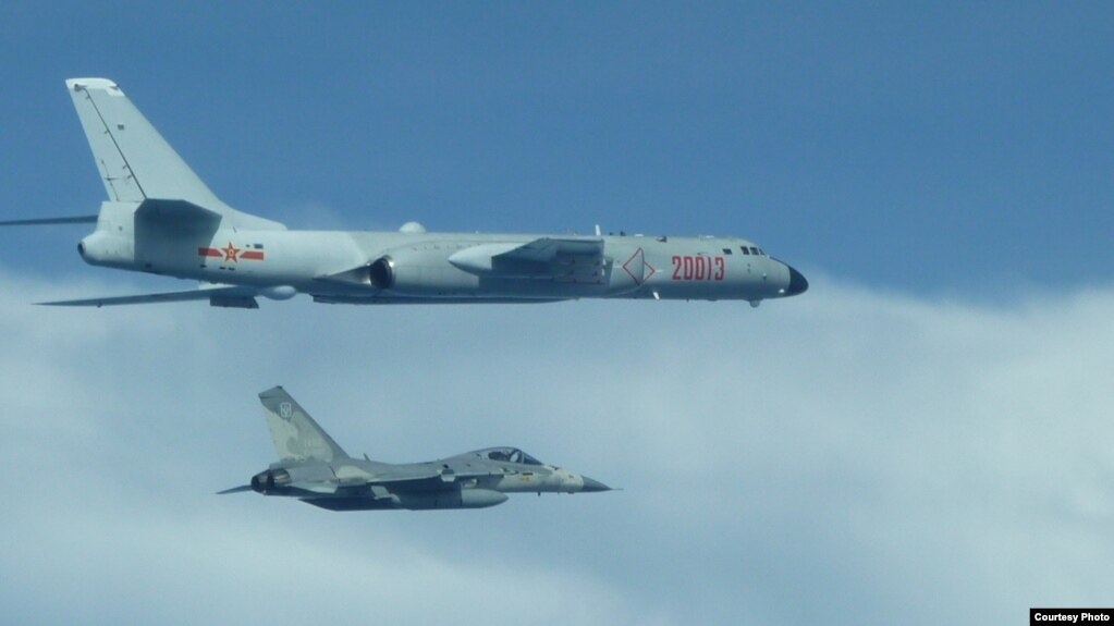 FILE - A Taiwanese fighter jet flew close to a Chinese H-6 bomber in 2017.