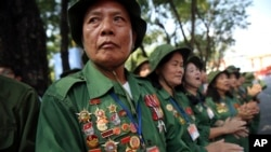 Vietnamese veterans gather for a parade celebrating the 40th anniversary of the end of the Vietnam War which is also remembered as the fall of Saigon, in Ho Chi Minh City, Vietnam, Thursday, April 30, 2015.