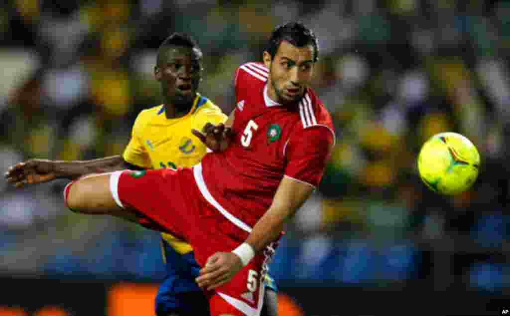 Morocco's Amine fights for the ball with Gabon's Charly during their African Cup of Nations soccer match in Libreville