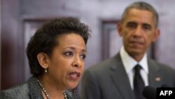 File - President Barack Obama (R) looks on as his nominee for US Attorney General, Loretta Lynch (L), the U.S. attorney in Brooklyn, NY, speaks during an event at the White House in Washington, D.C.