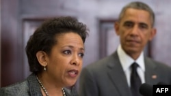 FILE - President Barack Obama, right, looks on as his nominee for U.S. Attorney General, Loretta Lynch, speaks during an event at the White House in Washington, D.C., November 8, 2014.