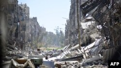 FILE - Destruction is seen at the Yarmouk Palestinian refugee camp near the Syrian capital, Damascus, April 6, 2015.