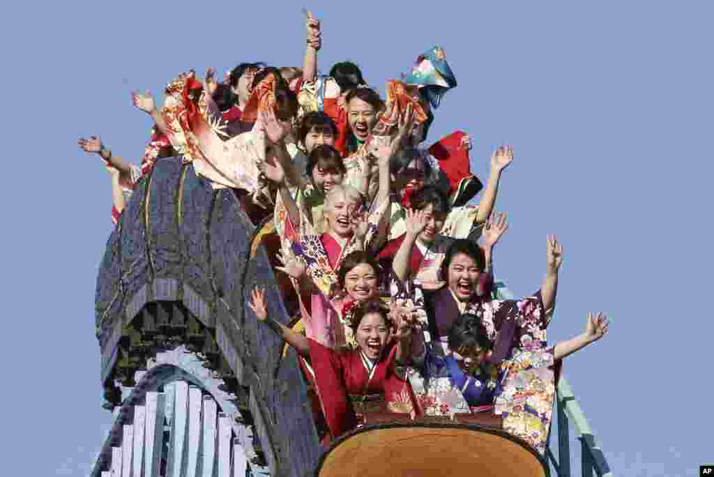 Kimono-clad women who celebrate turning 20 years old, react as they ride a roller coaster at Toshimaen amusement park on Coming of Age Day, a national holiday, in Tokyo, Japan.