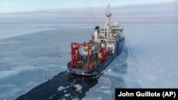 In this Nov. 14, 2019, photo provided by John Guillote the U.S. research ship Sikuliaq travels through sea ice in the Beaufort Sea off Alaska's north coast.