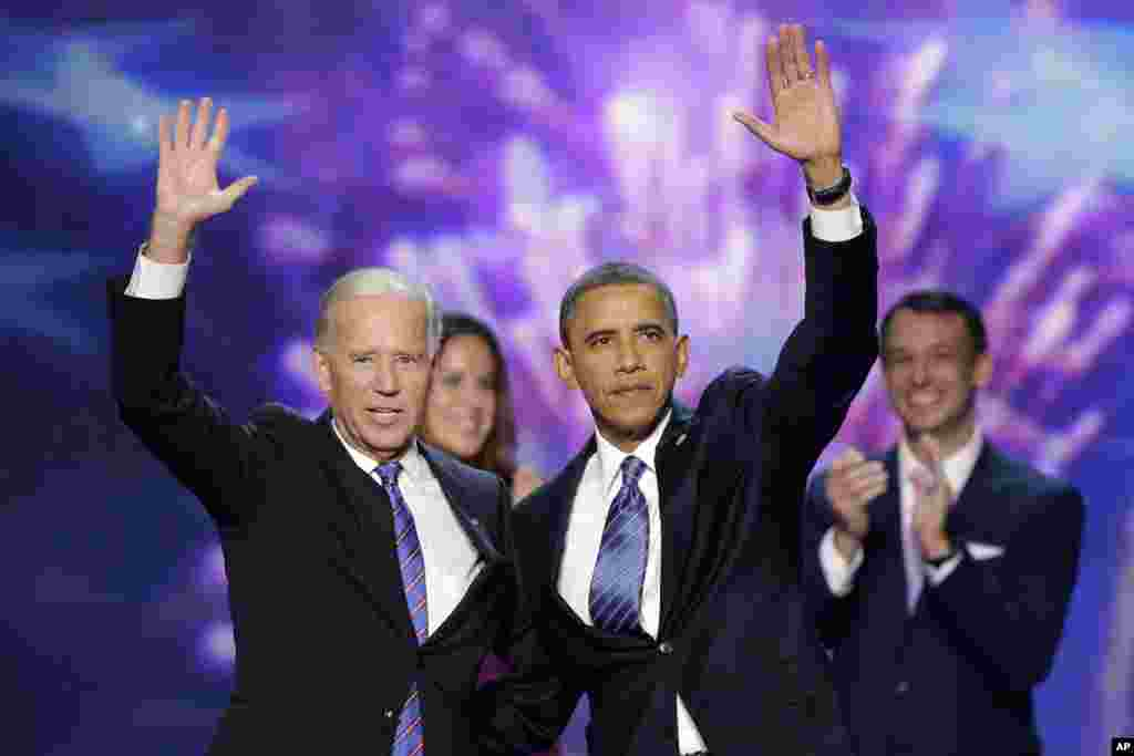 Vice President Joe Biden and President Barack Obama wave to the delegates at the conclusion of President Obama's speech at the Democratic National Convention, September 6, 2012.