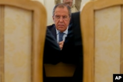 Russian Foreign Minister Sergey Lavrov listens to his counterparts from Sudan and South Sudan during their trilateral meeting in Moscow, Sept. 10, 2015.