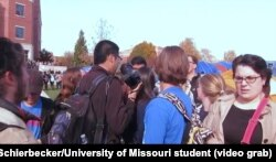University of Missouri student photographer Tim Tai is blocked from taking photographs by student protesters in Columbia, Mo., Nov. 9, 2015.