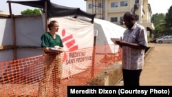 CDC epidemiologist Meredith Dixon confers with another physician at the Doctors Without Borders Ebola treatment center at Donka hospital in Conakry, Guinea, Dec. 19, 2014.