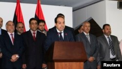Libya's new Prime Minister Ahmed Maitiq speaks at a news conference with members of the government in Tripoli, Libya, June 2, 2014.