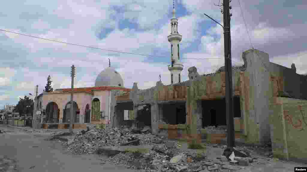 Damaged mosques and properties activists said were hit by shelling by forces loyal to Syria's President Bashar al-Assad, in Daraa, April 10, 2013.