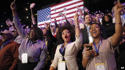 Supporters of President Barack Obama react to favorable media projections at the McCormick Place during an election night watch party in Chicago, Tuesday, Nov. 6, 2012.