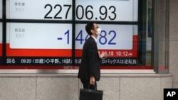 东京指数前一天(2018年6月18日)已经走低(美联社)