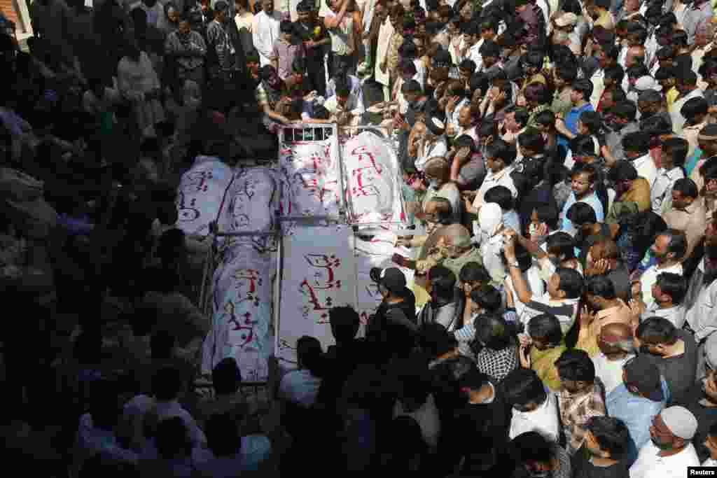 Shi'ite Muslims attend funeral prayers who those killed in a bomb attack a day earlier in Karachi, Pakistan, March 4, 2013.