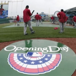 Los Angeles Angels players warm up before an opening day baseball game against the Kansas City Royals in Kansas City, Missouri
