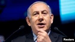 Israeli Prime Minister Benjamin Netanyahu speaks during the Muni World 2018 conference in Tel Aviv, Israel, Feb. 14, 2018.