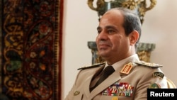 FILE - Egypt's Army Chief General Abdel Fattah al-Sisi at El-Thadiya presidential palace in Cairo, Nov. 14, 2013