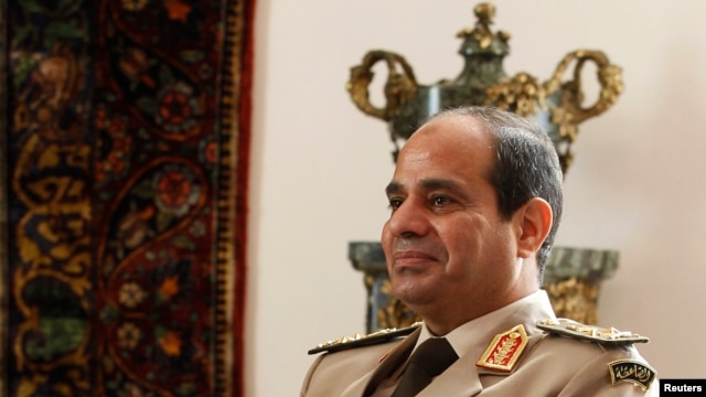FILE - Egypt's Army Chief General Abdel Fattah el-Sissi at El-Thadiya presidential palace in Cairo, Nov. 14, 2013.