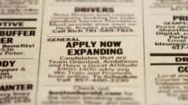 Classified section of Boston Herald calls attention to possible employment opportunities, Dec. 11, 2012.