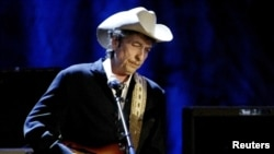 FILE - Rock musician Bob Dylan performs at the Wiltern Theatre in Los Angele, May 5, 2004.