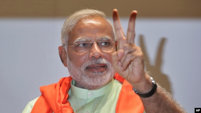 FILE - Gujarat state chief minister and the prime ministerial candidate of India's main opposition Bharatiya Janata Party (BJP), Narendra Modi,